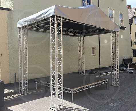 Small covered stage for street event.